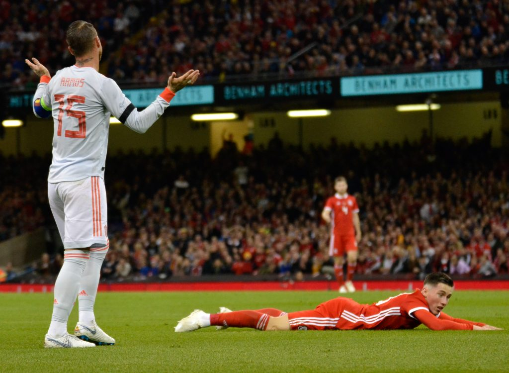 Sergio Ramos protests his innocence after a foul on Harry Wilson