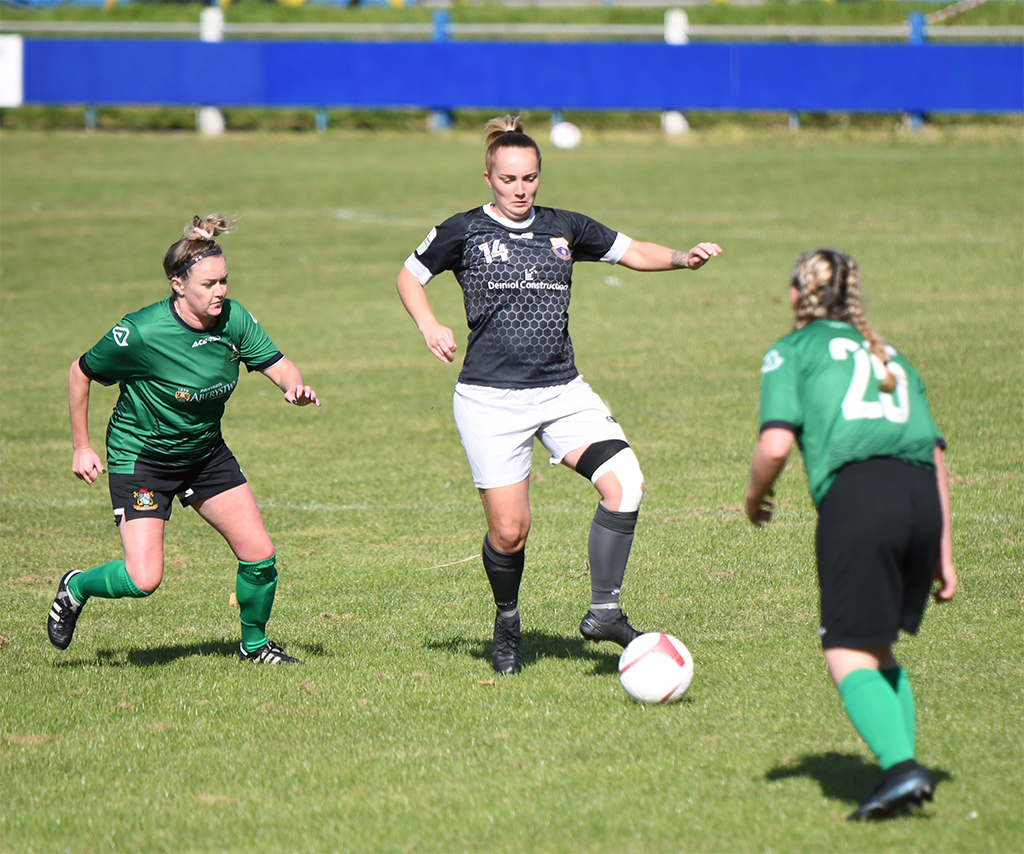 Port Talbot Town Ladies goal scorer Lauren Amor (centre) on the attack against Aberystwyth Town Ladies.