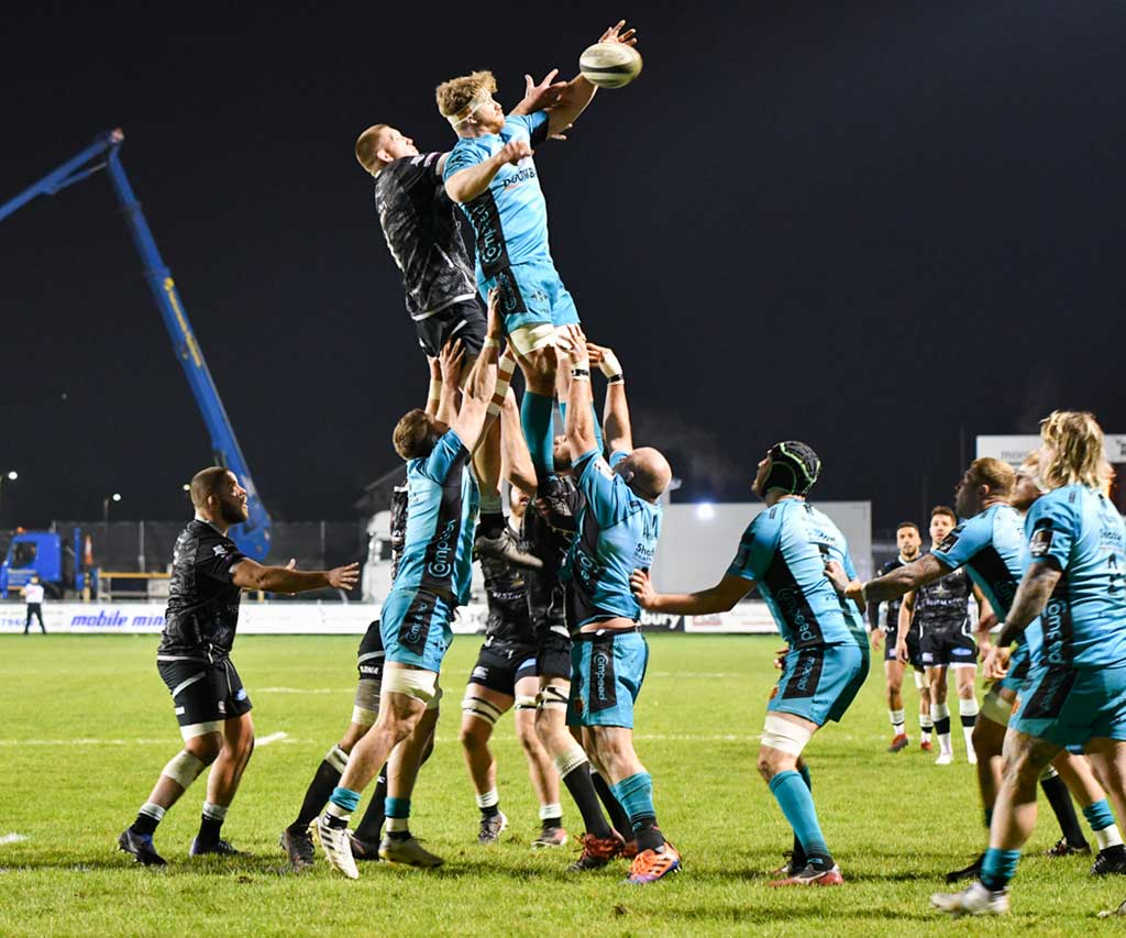 Dragons No 8 Aaron Wainwright climbs highest during a line-out against the Ospreys