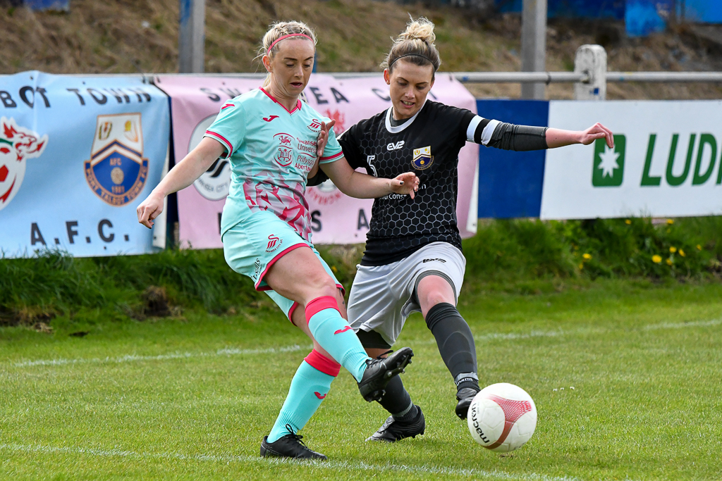Ria Hughes of Swansea City Ladies (left) battles with Chelsey Harris of Port Talbot Town Ladies