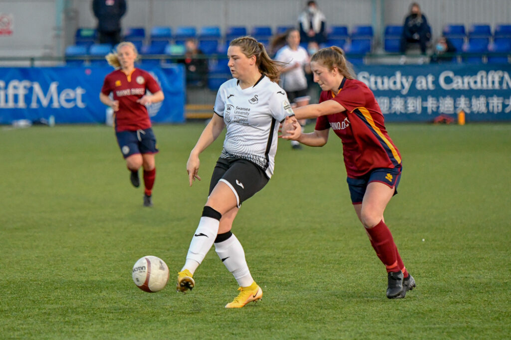 Chloe Chivers of Swansea City Ladies holds off the challenge from Lucy Finch of Cardiff Met Women